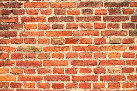 En fasad i Skåne kan behövas renoveras med tiden.